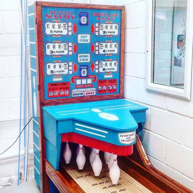 Can't accommodate a bowling alley in your house? This vintage bowling alley is the perfect alternative. #gamesroom