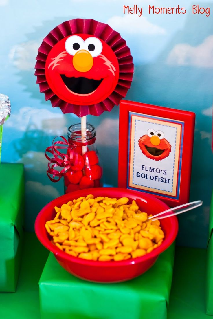 "My son just recently turned two and has been all about Elmo and Sesame Street (not to mention Thomas the Train!!).  To combine these two ""loves"" of his, I decided to have a party theme …"
