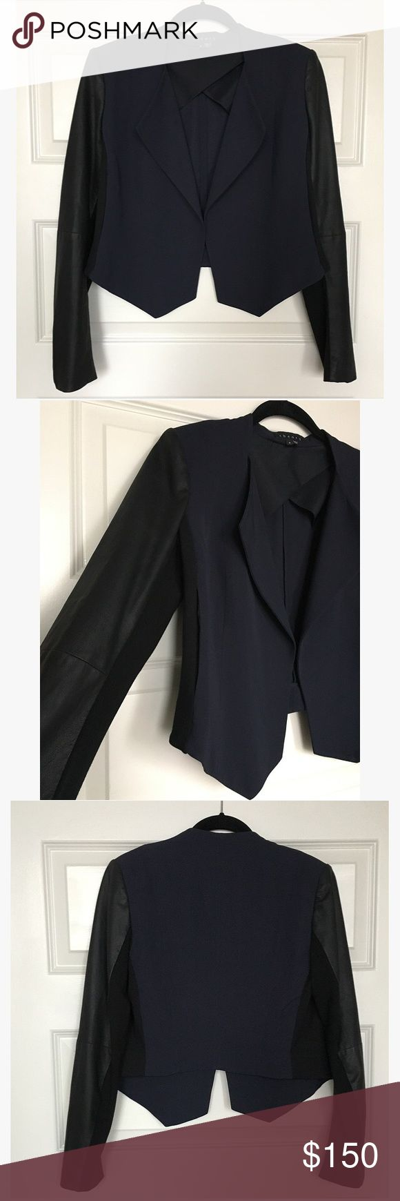 Theory Navy and Black Jacket with Leather Sleeve Theory - Navy and black deconstructed jacket with leather sleeve. Body of the garment is cropped in the back and slightly longer in the front. Body is viscose and sleeves are goat skin with knit inner arm. Thin shoulder pad, no closure, and partially lined. Dry clean only. Worn once. Theory Jackets & Coats Blazers