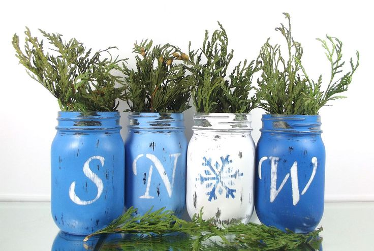 Let the snow start flying with this cute painted mason jar set!  This set would make a wonderful addition to your home decor, party decor or even as a gift for someone special! Each jar has been hand painted and adored with letters, that spell out the word S N O W. (Of course, the O has been replaced by a cute, blue snowflake.)  This set of jars have been painted lovely shades of blue. (The letters have been painted white and the snowflake has been painted a dark blue.) All the jars have a…