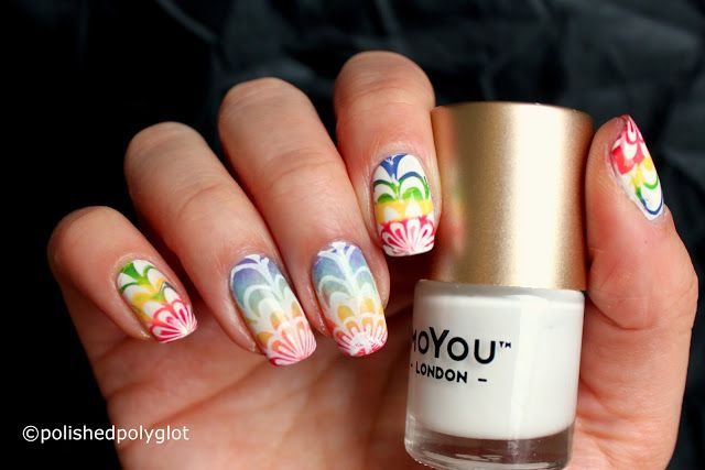 "Nail Art Rainbow Water Marble cheating [Nail Crazies unite] Hello my lovelies! I hope you are having a wonderful weekend so far! Today I'd like to show you myentry for the Nail Crazies Unite Challenge which prompted us to create a ""rainbow water marble"" manicure. Here is what I came up with I hope you like it! Well I LOVE rainbow manicures my rainbow manicure is my Facebook's Page cover but there is something I don't do that is water marble technique. Basically me and water marble nail art a"