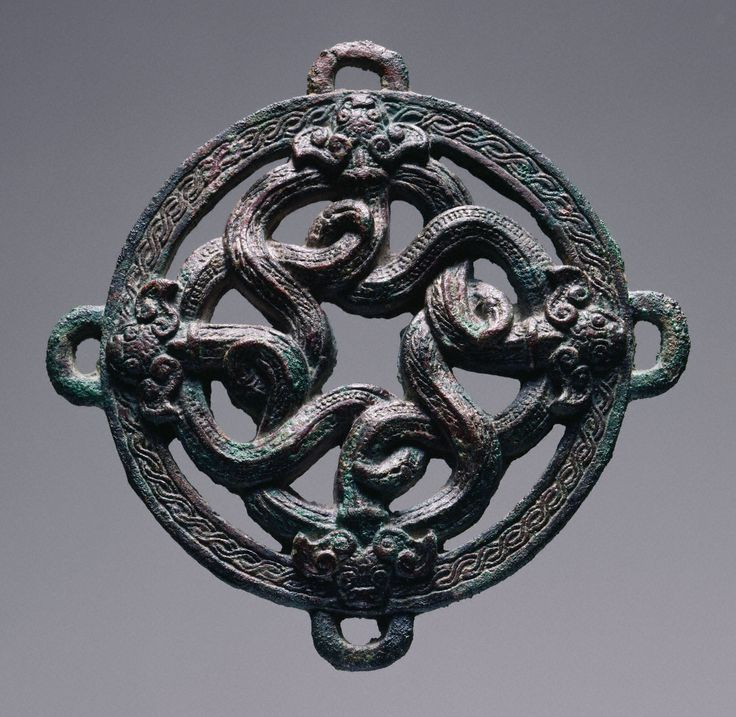 Chinese, Eastern Zhou dynasty, 770–256 B.C., Warring States period, ca. 470–221 B.C.                                Openwork roundel with entwined dragons, 5th century B.C.                Bronze with traces of gilding