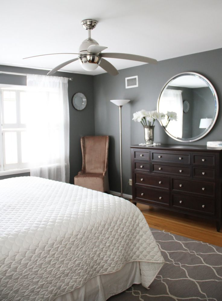 Benjamin Moore's Amherst Grey.  Love the paint color; just don't know how I'd sleep in that bedroom.  Too bright.  I would have to have room-darkening blinds.