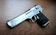 The Israel Military Industries Desert Eagle is a large-framed gas-operated semi-automatic pistol.  Mark XIX Desert Eagle in .50 Action Express with upgraded finger groove grip.  Current-model Mark XIX Desert Eagles now have a new-style Picatinny rail along the top of the barrel, as opposed to the dove-tail style rail on previous models. Magnum Research also now offers a proprietary muzzle brake for both the .50 AE and .44 Magnum versions to help reduce recoil.