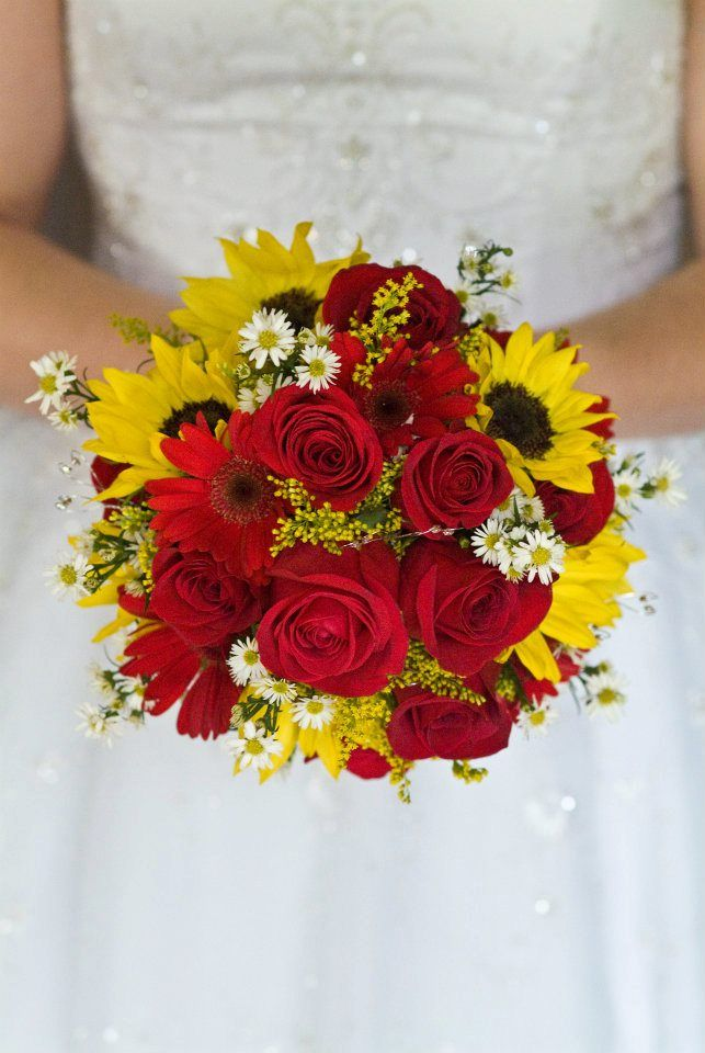 My '08 summertime wedding flowers... Red roses, red gerbera daisies, small yellow sunflowers, and mini white daisies. <3 <3