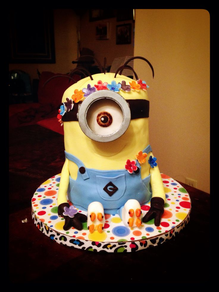 Minion cake flower child roller skate. I made for my niece. Tie dye cake with buttercream.