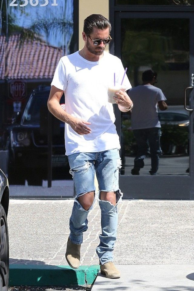 Scott Disick wearing  Saint Laurent Tan Suede Chelsea Boots, John Elliott Classic Crew T-shirt, Audemars Piguet Royal Oak Jumbo Chronograph Automatic 18K Rose Gold