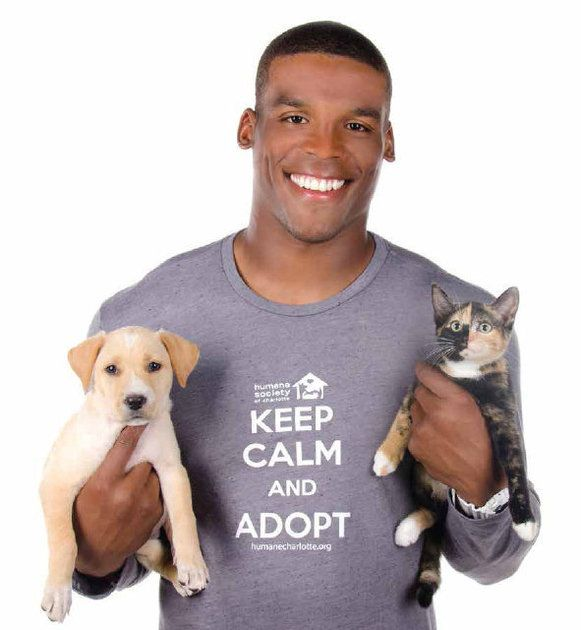 Cam Newton poses with puppies and kittens for Humane Society calendar cover