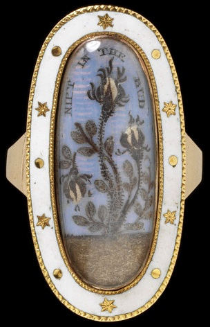 1792. This mourning ring was made to commemorate the death of a child, whose brief life is symbolised by the drooping rosebud on the left-hand side of the plant. According to the inscription, the child was called Butterfield Harrison and died on 14 March 1792 aged 2 years 9 months and 14 days. Although black is the colour most usually associated with mourning, white was used for children and sometimes for the unmarried.