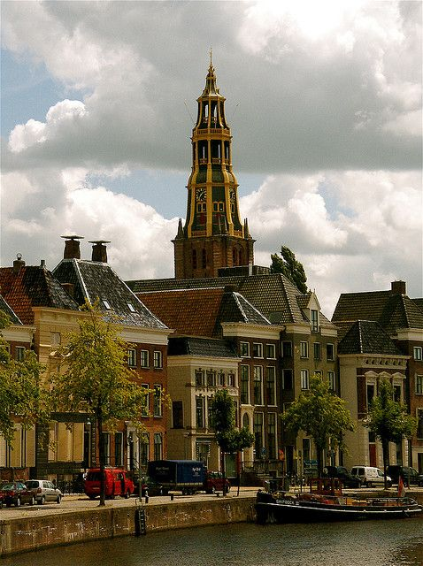 Church tower from the river in Groningen, Netherlands (by Akbar Simonse).
