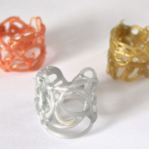 hot glue gun rings - measure your finger, lay piece of paper that length under glass or some other surface you can see through that the glue will peel off of easily.  Once you can peel it, do and flip to finish drying.  Form into ring shape and use more glue to secure.  Add glitter, rhinestones etc.  Make a bracelet to match!