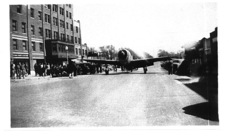 Plane driving down Broadway Street, Cushing, Oklahoma