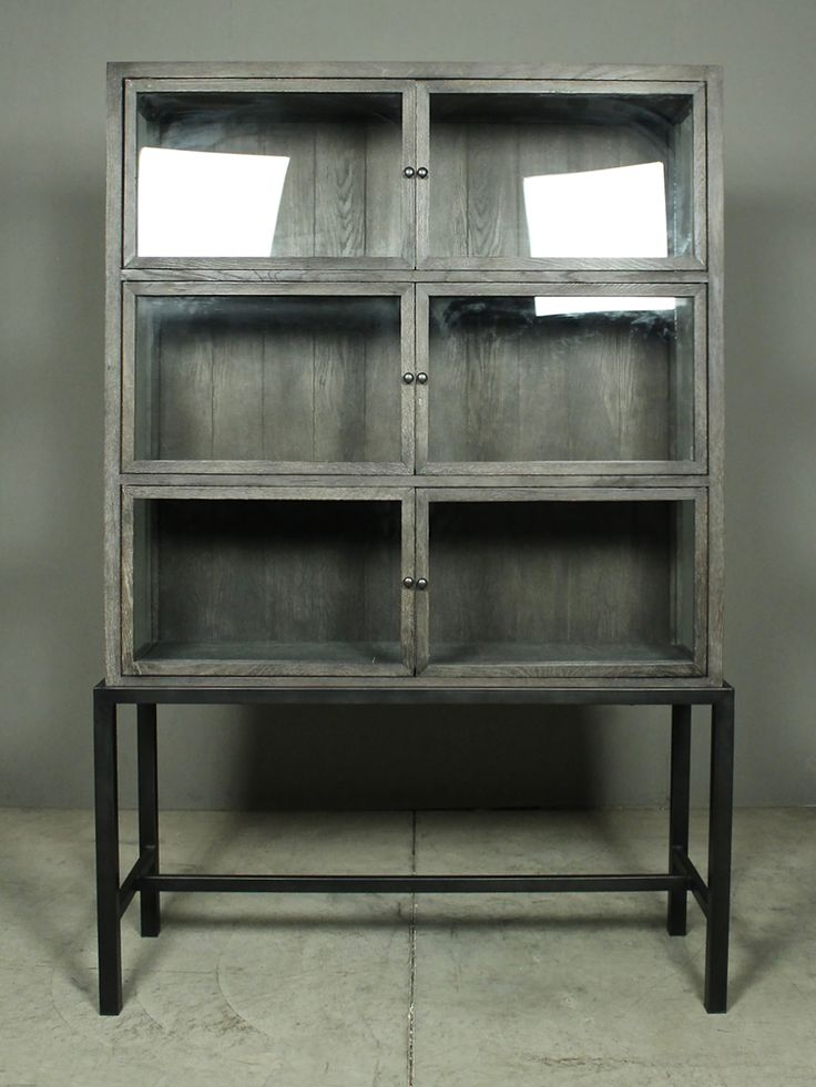 welsey cabinet | redinfred.com  steely grey solid oak + oak veneer bring warmth + naturalness to this chic + sophisticated storage cabinet, perched upon a waxed black steel frame.