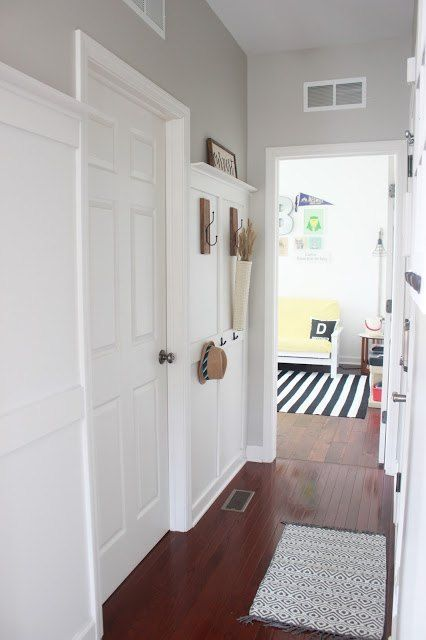 s 9 tricks to turn builder grade baseboards into custom made beauties, wall decor, woodworking projects, Top your off with board and batten walls