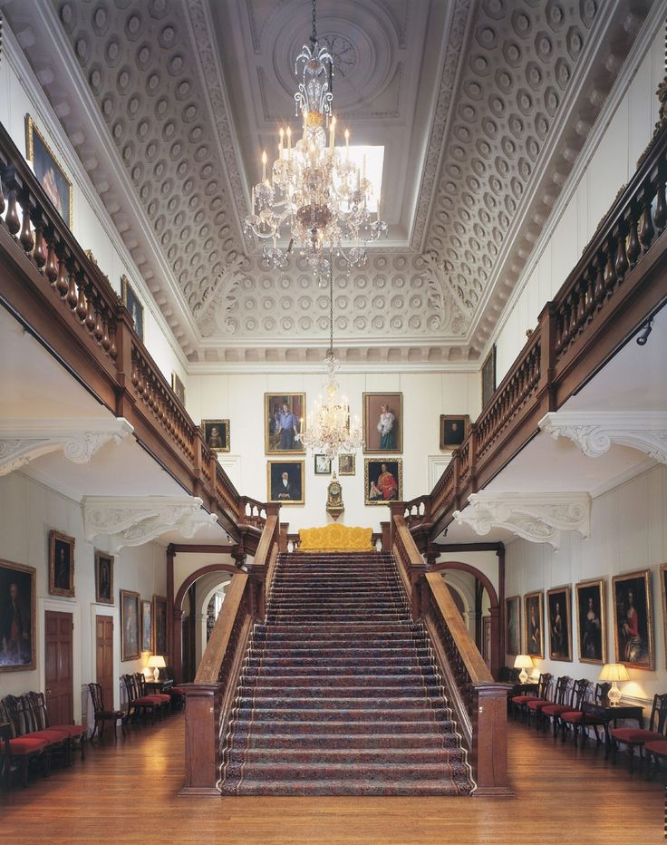 Grand staircase with coffered ceiling