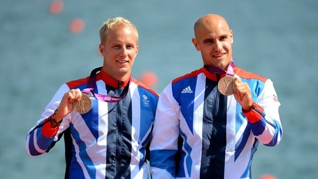 Bronze medal winners Liam Heath and Jon Schofield of Great Britain display their medals after the Victory Ceremony for the men's Kayak Double (K2) 200m Canoe Sprint.