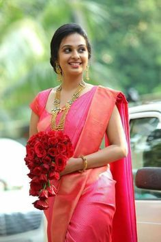 Pink rose colour silk saree with red rose on hand bride
