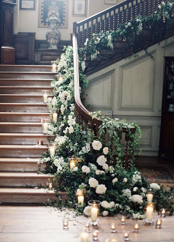 flora garland and candles decorated wedding staircases