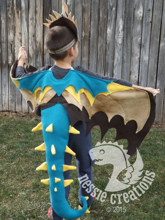 Kids Dragon Wing and Headpiece Costume  Fun and playful wings and mask. Let your childs imagination run wild.  ONE of a KIND!! No 2 wings will be alike.  Hand cut and pieced together by me. Wings cut with pinking shears for added texture, Fleece will NOT fray!  Neckline reinforced, so it will endure the hours of endless fun your child will have soaring up above the clouds or battling knights. Long ribbon to secure wings at wrist and neckline. ***Sizing guide:  XS......18 mo to 2T…