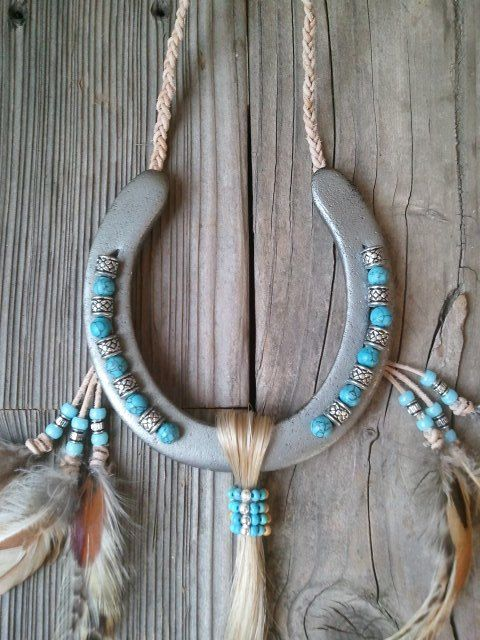 This horseshoe gets its inspiration from the Native American culture. This particular design uses an unpainted horseshoe which only has clear