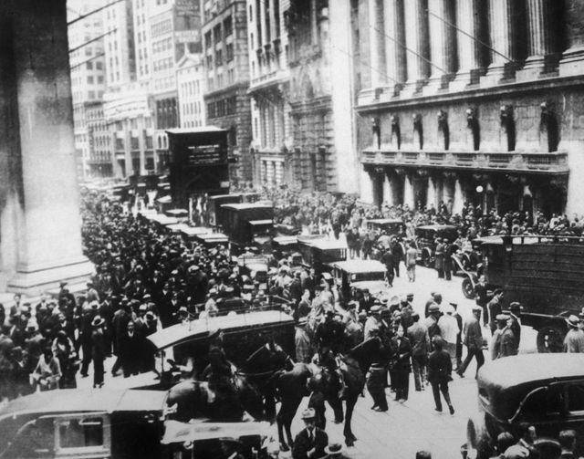 Causes and Effects of the 1929 Stock Market Crash: 29th October 1929.: Workers flood the streets in a panic following the Black Tuesday stock market crash on Wall Street, New York City.