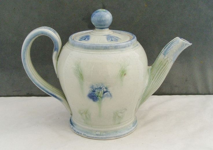 "Studio Pottery Teapot made by A&J Young Pottery in Gresham, Norfolk. Lovely Cornflower design. It measures 6.5"" high to the top of the lid. The Teapot is fully marked around the bottom edge as shown. 
