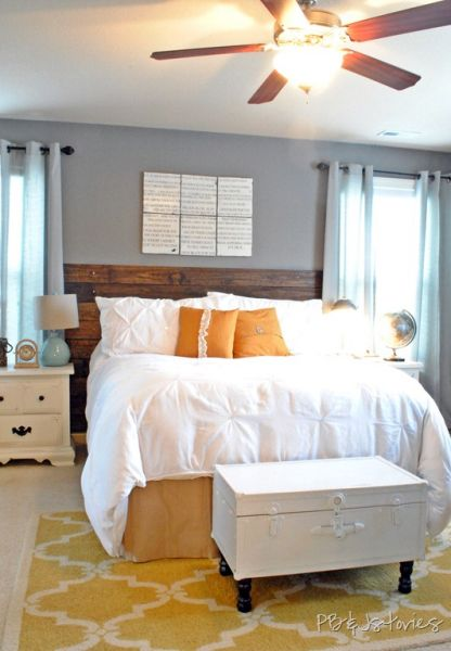 white bedding, distressed headboard and accents of yellow and orange. what's not to like?