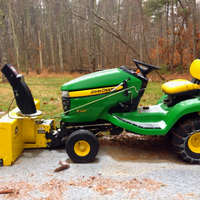 "John Deere X300 with 46"" two stage snow blower attachment"