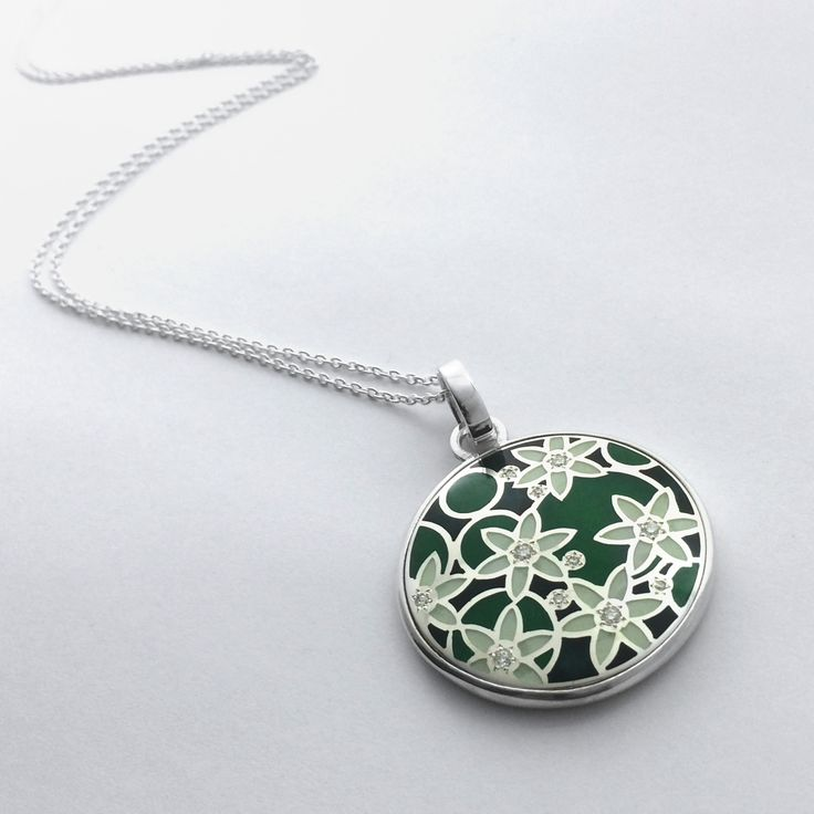 Waterlily pendant. Enamel, & diamonds in silver. Designed & made by Geoff Mitchell. Australia.