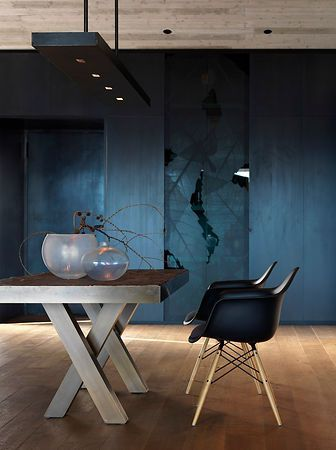 Great composition. Eames chair + cross in the table legs.