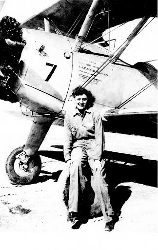 "Gwen ""Clink"" Linder of Port Charlotte, Fla. sitting on the wheel of her Stearman PT-19 open cockpit trainer at Avenger Field in Sweetwater, Texas in 1944. This was the first plane she flew as a member of the Women Air Force Service Pilots (WASP's)."