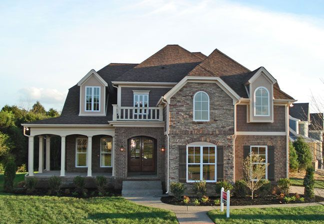 I love the wrap around porch and double doors at the front.