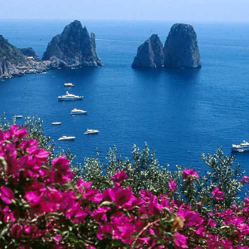"""Magical Capri, which Jean Paul Sartre defined """"Island"""" with capital """"I"""", seems immutable in time, a stupendous pearl mounted as a jewel upon the sea...."""