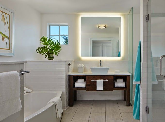 House of Turquoise: The Marker Resort - Key West. Love the lighting behind the mirror.