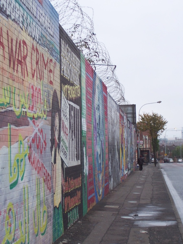 Belfast Peace Wall - Longer, Older, and Higher than the Berlin Wall ever was. It has drawings on it from Bill Clinton to the Dalai Lama. It's higher than the double decker bus that we road on to see it.