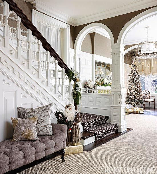 Love the dark paint on top and crisp white 1/3 of the way up the wall. Festive Holiday Staircases and Entryways | Traditional Home