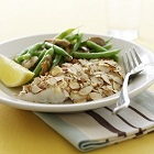 Baked Cod with Toasted Almonds.  Use allowed butter or oil in place of margarine.