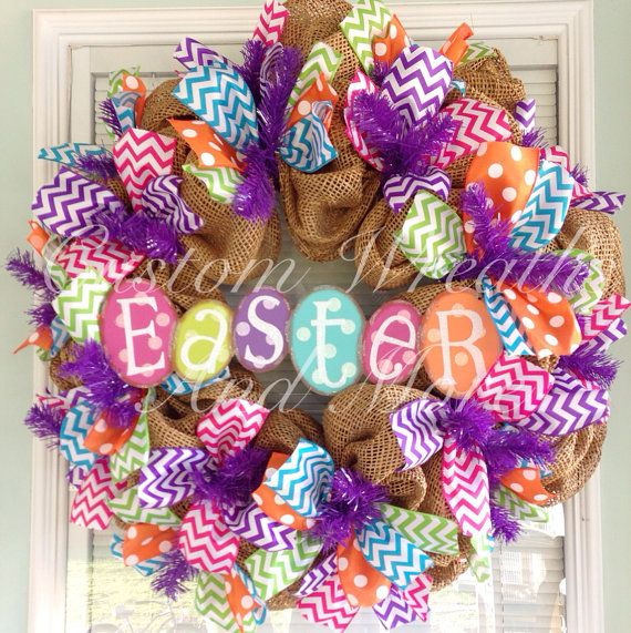 Thinking I might try to do a similar wreath myself.  Easter wreath with mesh burlap and chevron in spring colors and metal Easter egg sign.
