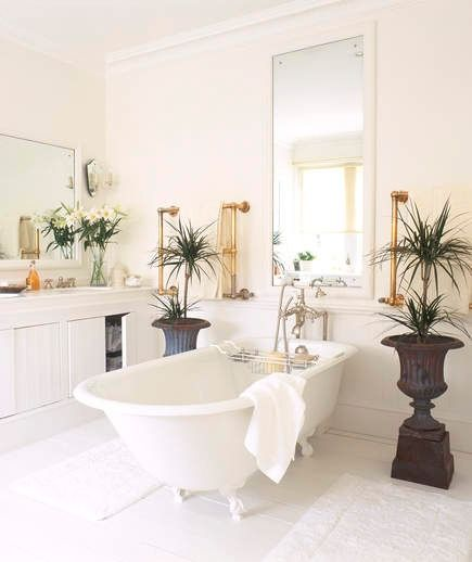 Bring Nature In | Add some life to your calming oasis with flowers, plants, and herbs. There are tons of potted plants that thrive in the humidity of a bathroom and keep the air clean. And, as Jessica McCarthy of the interior design site, Decorist, points out, due to the general moisture of this room, the plants will require less maintenance.