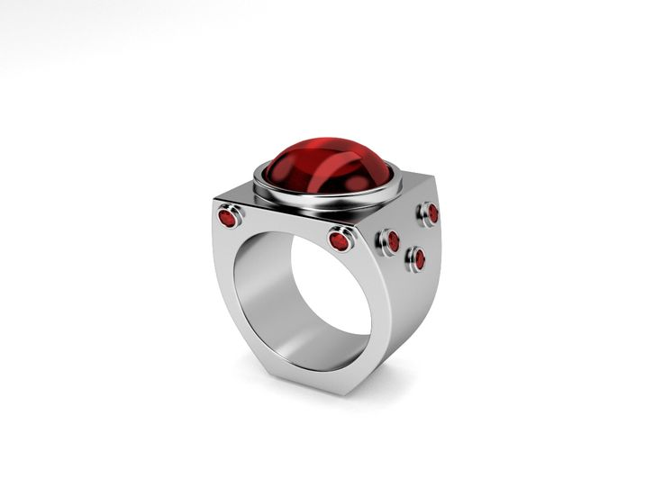 The CARSON Ring with a 14mm garnet cabochon and ten faceted bezel set accent stones.