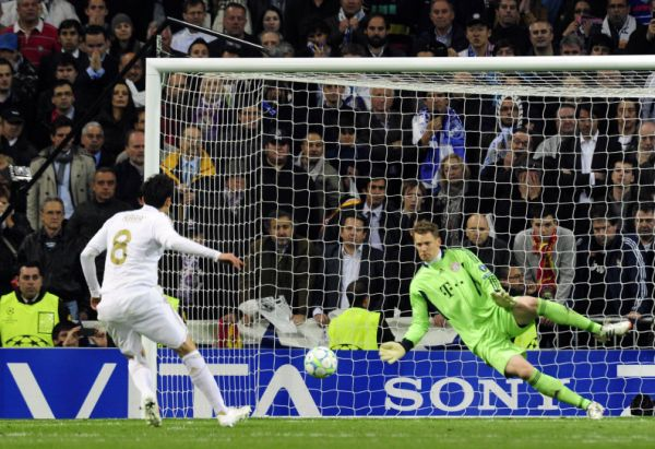 Bayern Munich's goalkeeper Manuel Neuer (R) stops a penalty kick from Real Madrid's Brazilian midfielder Kaka (L) during the UEFA Champions League second leg semi-final football match Real Madrid against Bayern Munich at the Santiago Bernabeu stadium in Madrid on April 25, 2012.