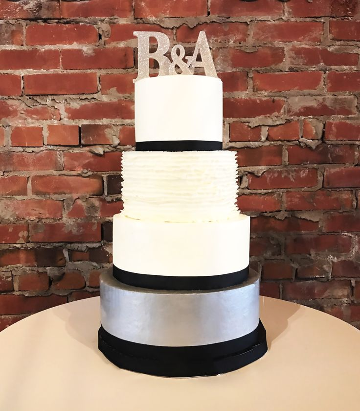 Silver metallic wedding cake with initials for a NYC wedding