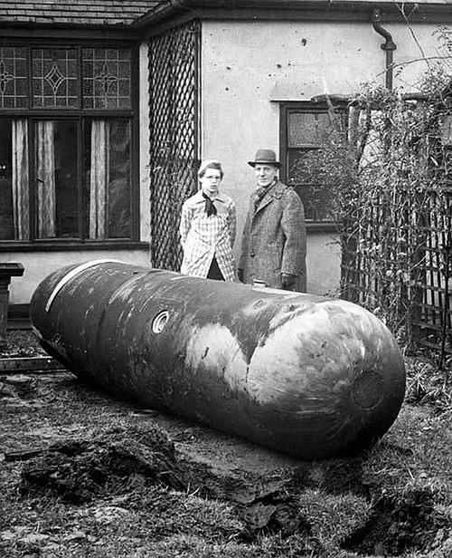 """Unexploded German parachute mine in somebody's back yard, Liverpool Nov 1940. Look how stoic those old Brits were. """"Bomb in the garden, wot? Ah can't be helped, can't be helped. Come in for some tea, won't you?"""""""