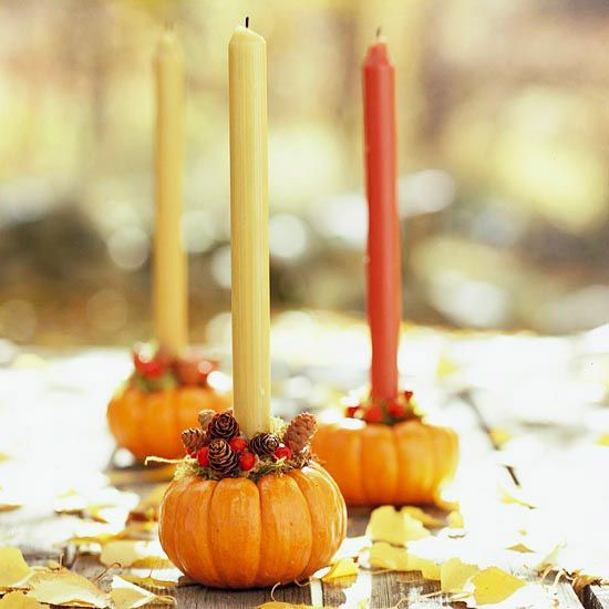 Pumpkin Tabletop Accent  -            Turn mini pumpkins into delightful candleholders for an autumnal centerpiece. For each pumpkin, remove the stem and drill a hole in the top. Insert a candle into the hole, and glue some small pinecones and berries around the base of the candle to finish.