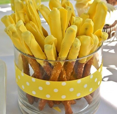 More party ideas-chocolate dipped pretzel rods - any color to match party theme.  Ribbon around container to match.