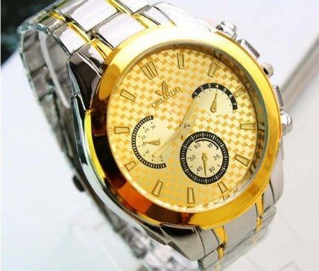Luxusné pánske hodinky Orlando v zlatej farbe. Sleduje svoj čas štýlovo s týmito luxusnými hodinkami v zlatej farbe. Hodinky Orlando Vás uchvátia svojim vkusným, elegantným a nadčasovým dizajnom. Remienok je vyrobený z chirurgickej ocele v striebornej farbe. Pokiaľ chcete spestriť svoj outfit a sledujete aktuálne módne trendy, tieto hodinky sú určené práve pre Vás. Malé ciferníky slúžia len ako dekorácia hodiniek. http://www.luxusne-doplnky.eu/