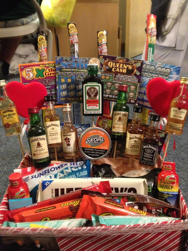 Made my boyfriend a manly valentines day basket! Filled with shots, scratch offs, slim Jim's and all his favorite candies and snacks