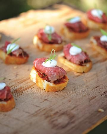 Beef carpaccio with sun-dried tomatoes, creme fraiche, and basil on toasted French bread.