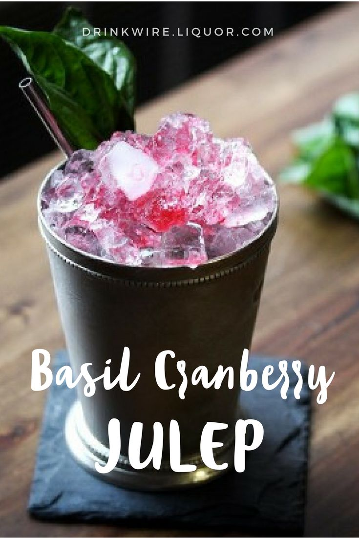 Here's the holiday twist on a summer classic cocktail! Mezcal, cranberry and basil make this into a perfect day drinking cocktail that is perfect in hand surrounded by family!