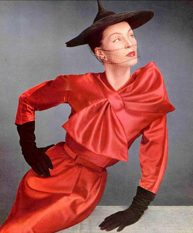 1951 Lucky in geranium red satin cocktail dress with large bow at neckline by Lanvin-Castillo, photo by Pottier